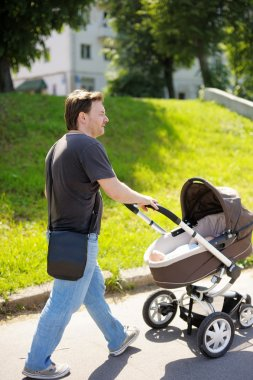 Man walking with baby stroller