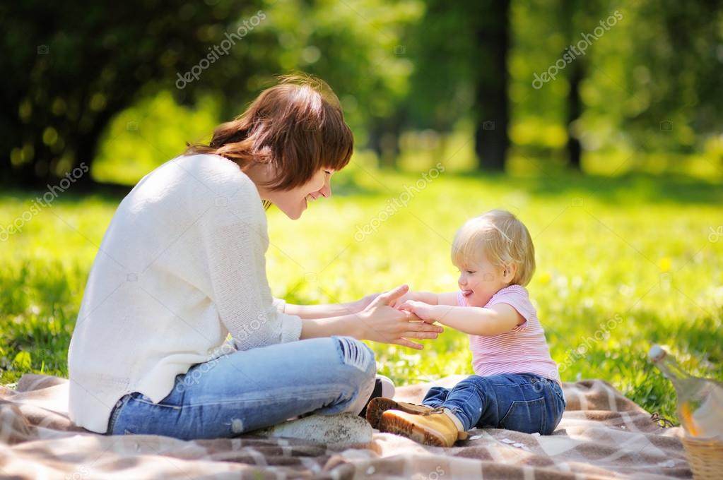 Young woman and her little son having fun