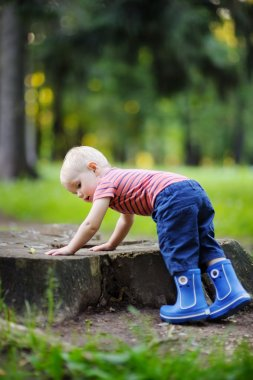 Toddler playing outdoors
