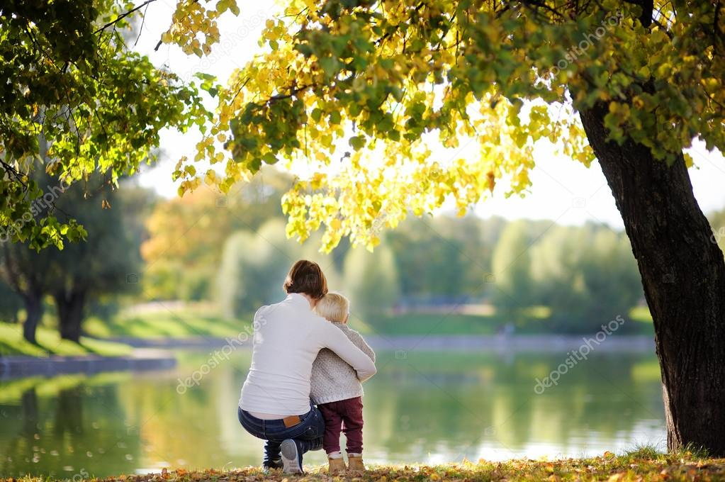 Woman and her toddler son in park