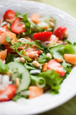 salad with strawberries and cantaloupe