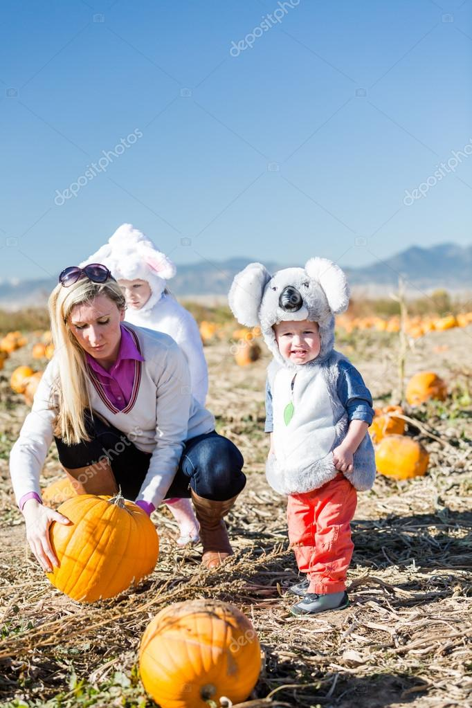 Mother with kids in Halloween Costumes