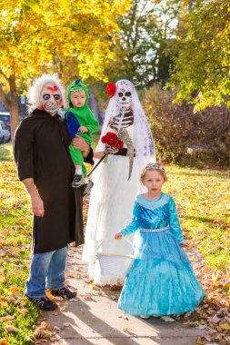 Family in costumes on Halloween night