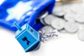 Photo Blue dreidel with silver tokens