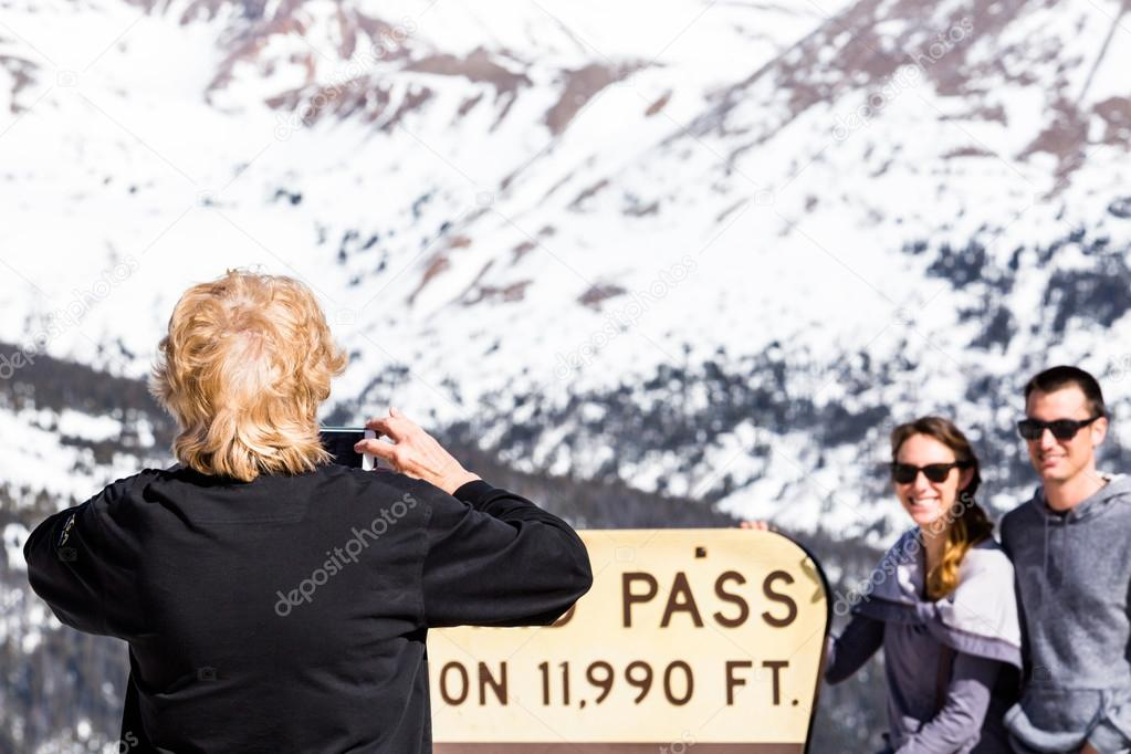 People take pictures at Loveland pass