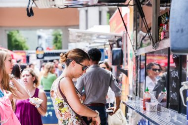 Gathering of gourmet food trucks and carts