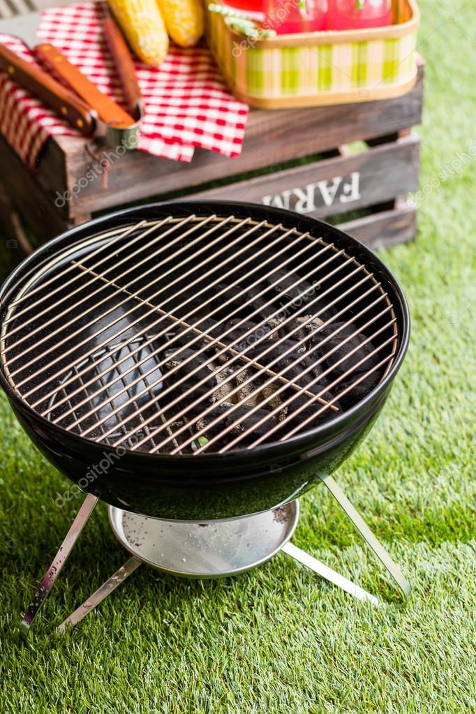 small charcoal grill in the park.
