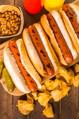 Grilled hot dogs on a white hot dog buns