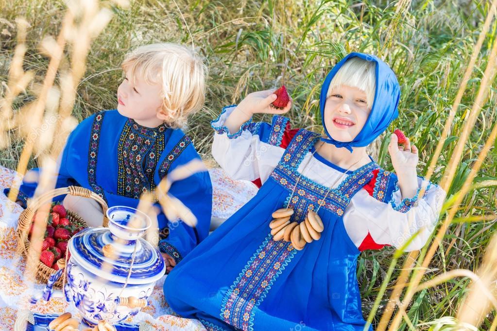 little kids in Russian costumes