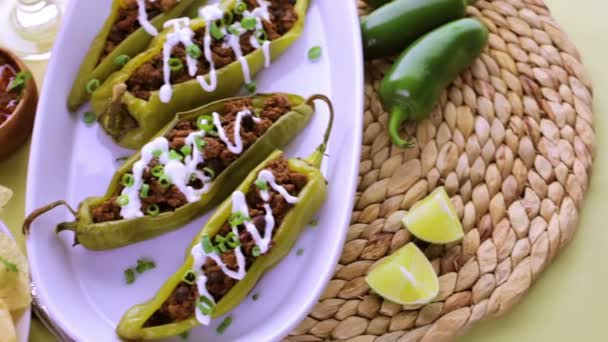 Chipotle beef and bean stuffed chile peppers