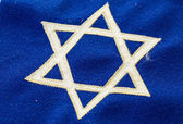 Fotografie Star of David on blue banner flag