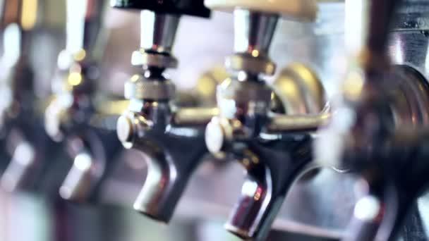 pouring draft beer at bar