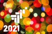 Christmas background-garlands with colorful lights on a decorated Christmas tree, bokeh, Happy New Year 2021 colored symbol and text in trendy flatten style design for seasonal holidays flyers