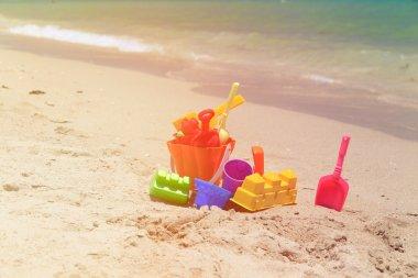 kid toys on sand beach