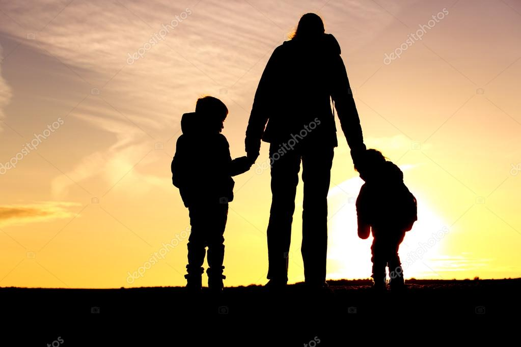 Family Travel Mother And Two Kids With Backpacks At Sunset Stock