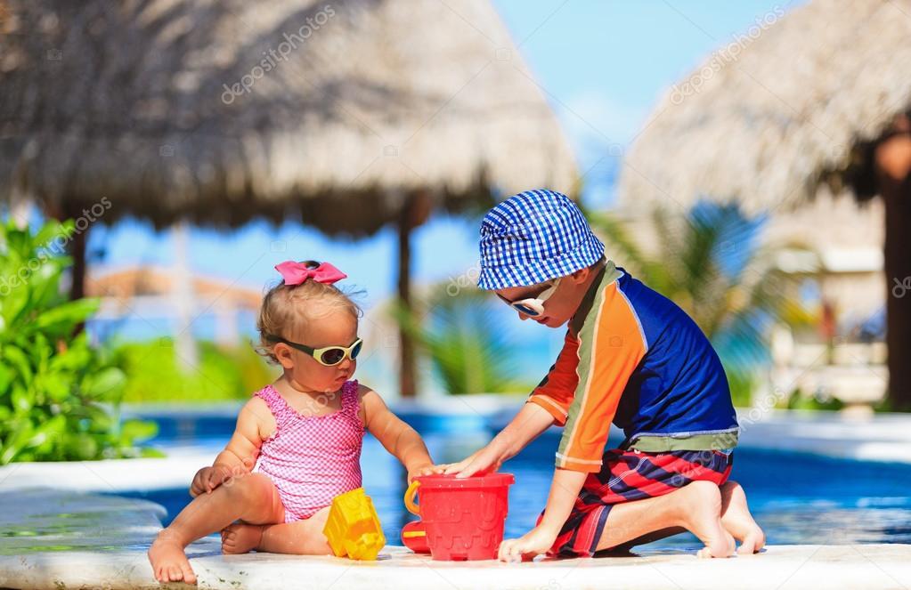 kids playing in swimming pool — Stock Photo © Nadezhda1906 ...