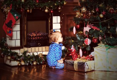 Little girl with presents at christmas