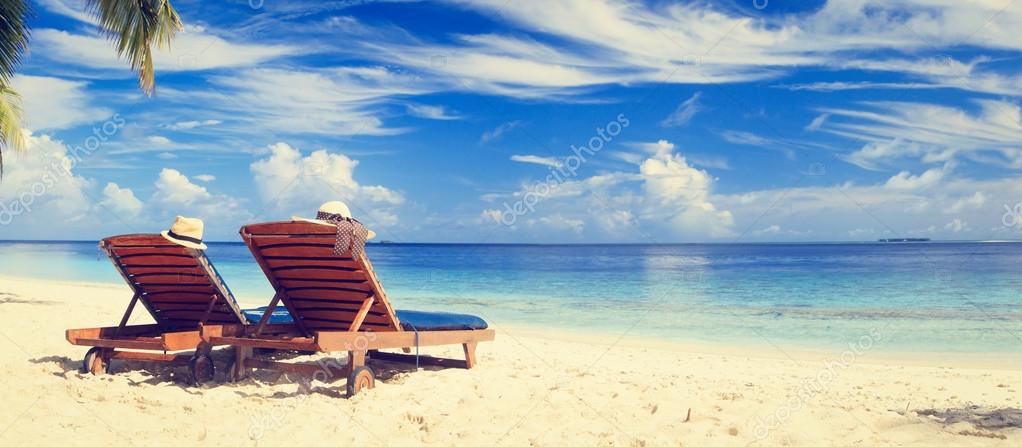 Two chairs on tropical sand beach