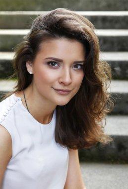 Portrait of a beautiful brunette outdoors stock vector