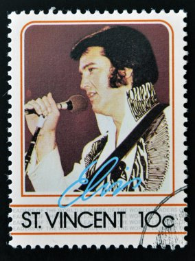 ST. VINCENT - CIRCA 1985: A stamp printed in St. Vincent, shows Elvis Presley, circa 1985.