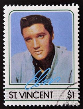 ST. VINCENT - CIRCA 1985: A stamp printed in St. Vincent, shows Elvis Presley, circa 1985.
