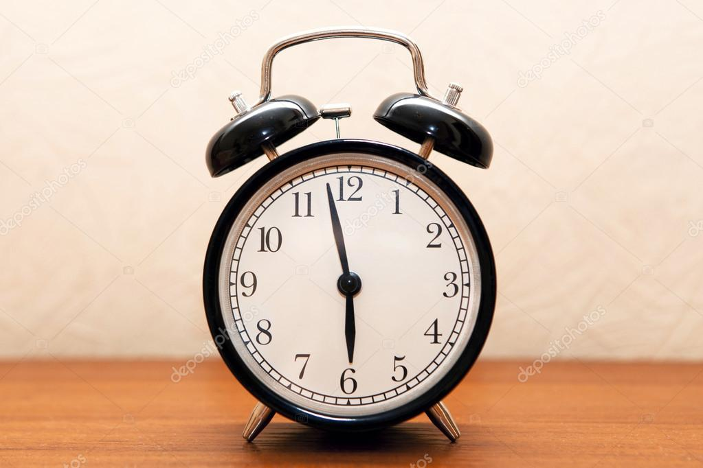 Alarm Clock On The Bedside Table In The Room U2014 Stock Photo