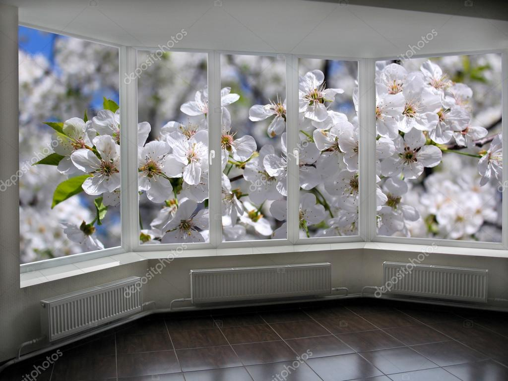 plastic windows overlooking the blooming garden