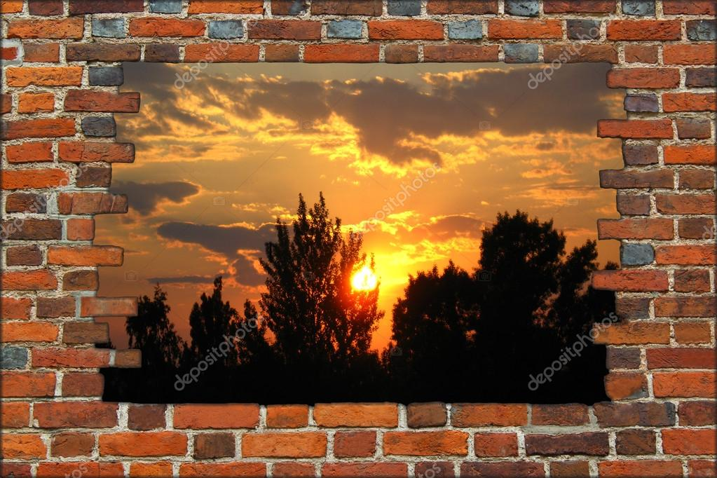 Broken brick wall and view to the sunset