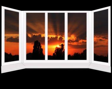 big plastic windows with beautiful sunset beyond it