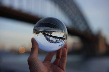 View of Sydney Bridge through a crystal ball