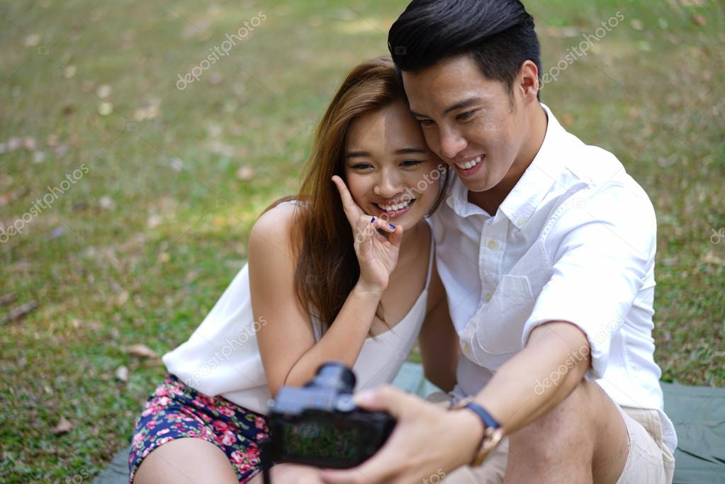 Happy dating couple using camera to document their love relationship —  Photo by Jacetan