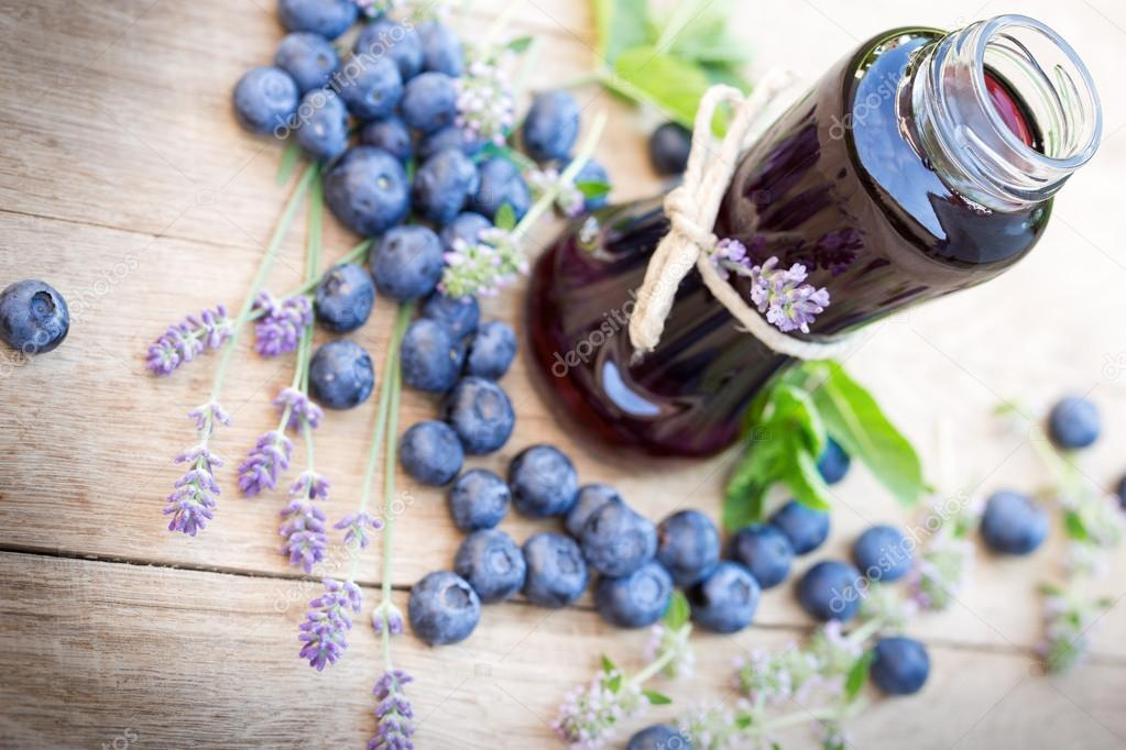 Blueberry juice in jar on table