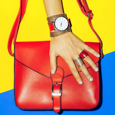 Bright Summer Accessories. Bag and Jewelry. Focus on red.