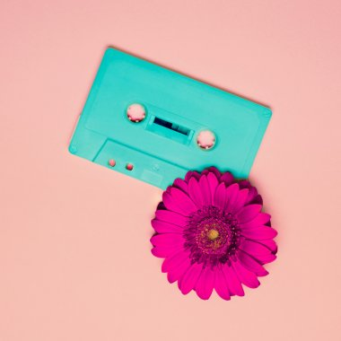 Cassette tape and flower. Minimalism Retro Style.
