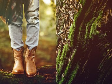 Autumn cowboy style. Cowboy boots in the woods