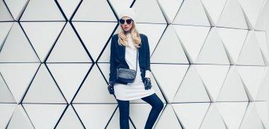 Glamorous blonde on the street. urban fashion