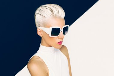 Blonde model in trendy sunglasses with stylish Haircut. Fashion photo stock vector
