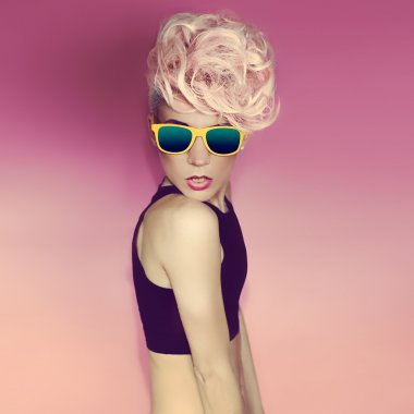 crazy disco punk Girl on pink background. glamorous party