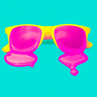Exclusive yellow hipster sunglasses on blue background. dripping