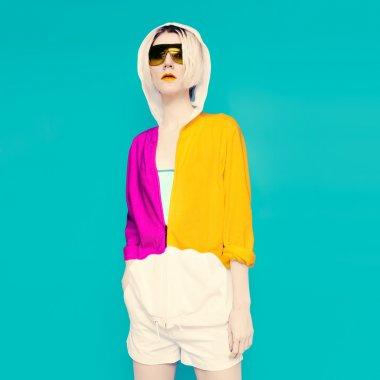 Sportswear fashion. Glamorous blonde on blue background.