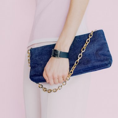 Glamour girl with trendy clutch. Vanilla style. Stylish accessor