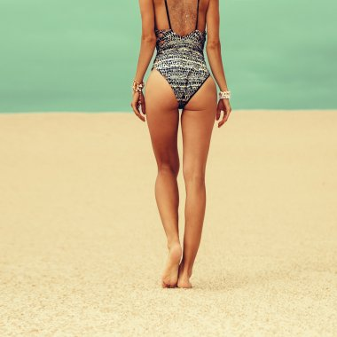 Glamour model in swimsuit  and accessories trends Beach season
