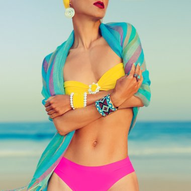Glamorous lady in fashionable swimsuit and stylish accessories a