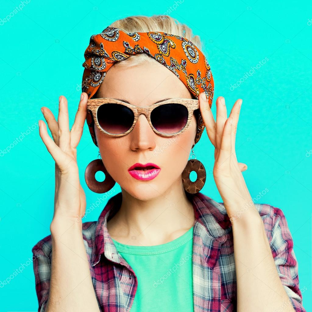 Fashion blond girl in trendy hair accessories. Headscarf.