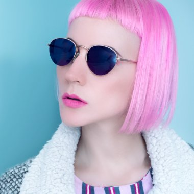 Pop Lady style fashion vintage glasses and pink hair.