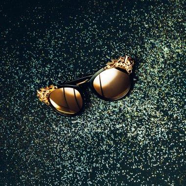 Sunglasses luxury style on black shiny background. Glam chic
