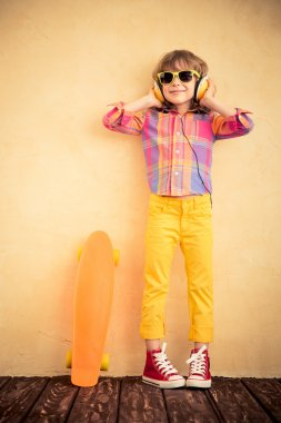Hipster child with skateboard