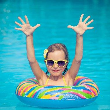 Kid in swimming pool
