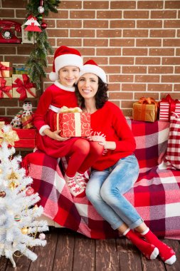 Mother and daughter with Christmas gifts