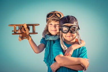 Happy children playing with toy airplane
